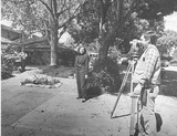 Civil engineers discuss a Palo Alto flood zone with homeowner, 1990