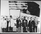 American Legion members with flag