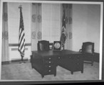 A desk with a large Herbert Hoover Medal